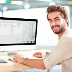 43954240-young-man-working-on-computer